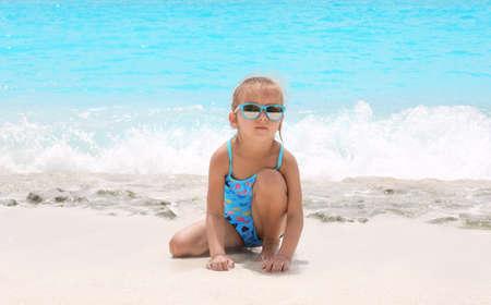 Cute little girl on sea beach Standard-Bild