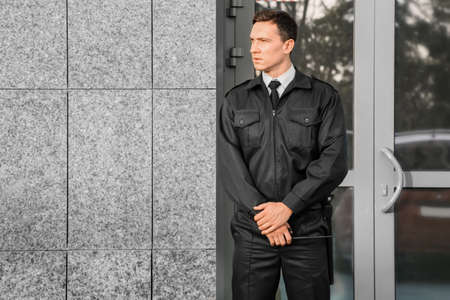 Male security guard, outdoors Banque d'images