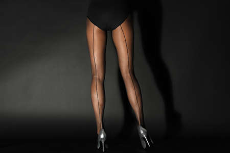 85e33de6df703b Archivio Fotografico - Legs of beautiful young woman in tights on dark  background