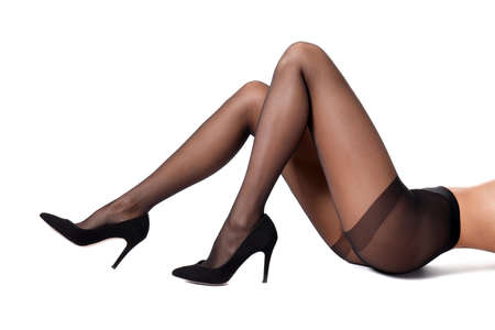 Legs of beautiful young woman in black tights on white background 版權商用圖片