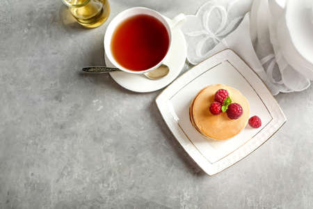 Plate with delicious pancakes on table Stock Photo