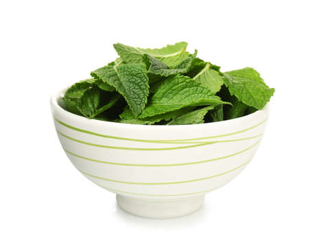 Bowl with fresh mint leaves on white background