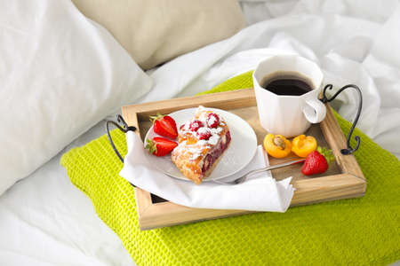 Delicious breakfast on bed