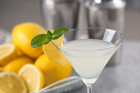 Glass with tasty lemon drop martini cocktail on table, closeup Stock Photo