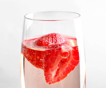 Glass of delicious strawberry wine, close up