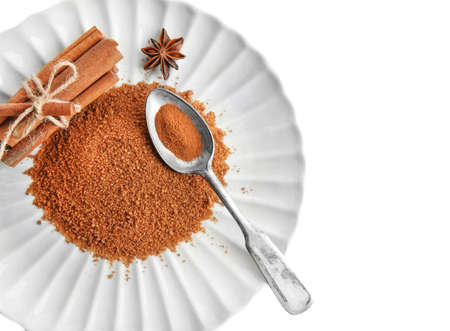 Plate with sweet cinnamon sugar on white background Stock Photo