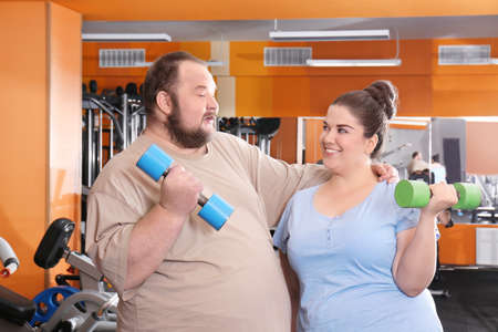 Overweight couple in gym