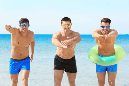 Handsome young men on sea beach