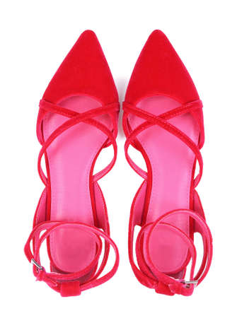 Pair of classic female shoes with crisscross straps isolated on white Stock Photo