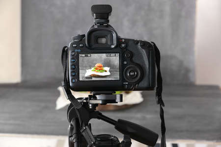 Professional camera on tripod while shooting food Фото со стока
