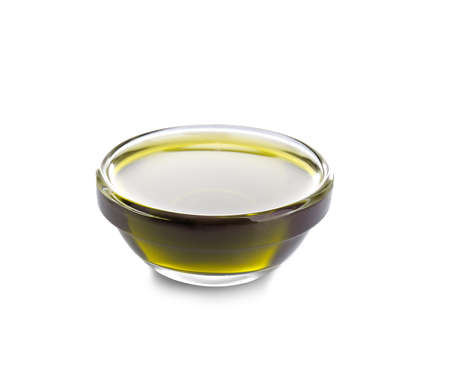 Bowl with hemp oil on white background