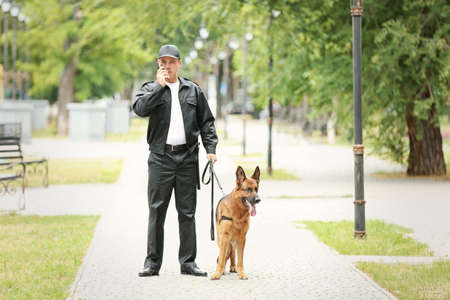 Security guard with dog in park