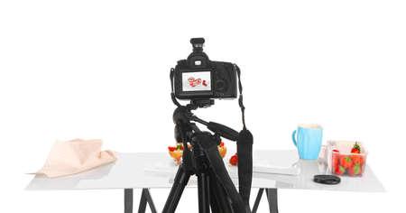Professional camera on tripod while shooting food Stock Photo