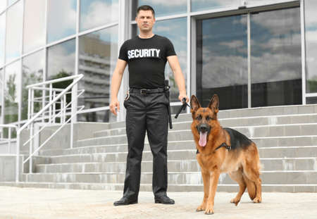 Security guard with dog near building Stock fotó