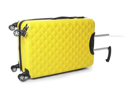 Yellow plastic luggage with broken handle and wheel isolated on white Imagens