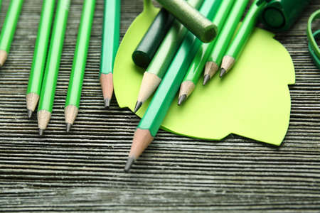 Sharp green pencils and office supplies on grey table