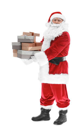 Happy authentic Santa Claus holding a pile of gift boxes on white background