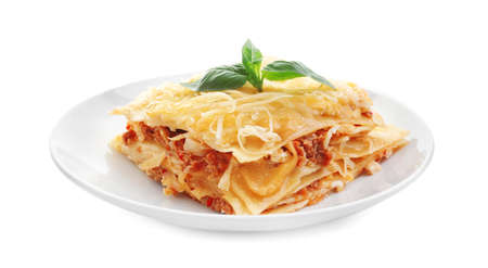 Portion of tasty lasagna, isolated on white background