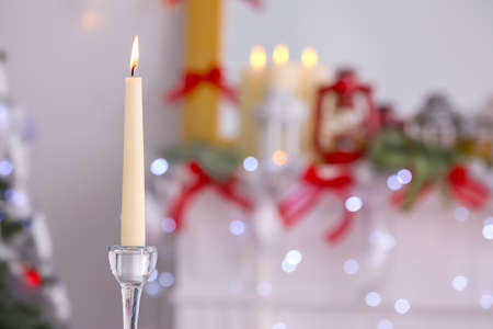 Christmas candle on blurred background