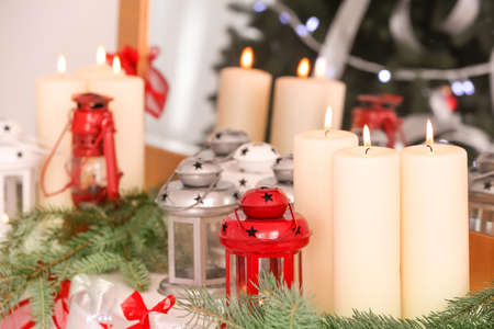 beautiful christmas decorations and candles on mantelpiece at home stock photo 98191609