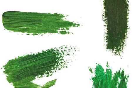 Green oily paint brushstrokes on white background