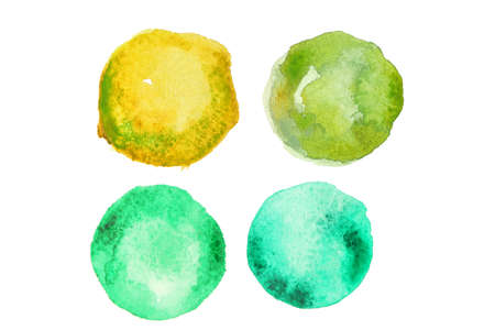 Green watercolor paint in shape of circles on white background
