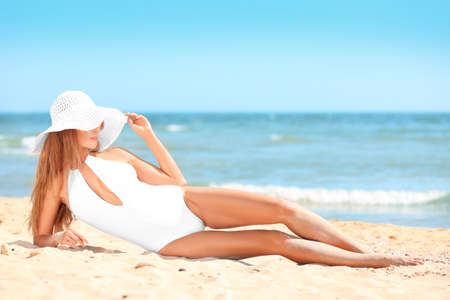 Beautiful young woman on sea beach Stock Photo