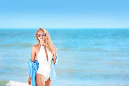 Beautiful young woman on sea beach
