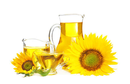 Composition with cooking oil and sunflowers on white background Archivio Fotografico