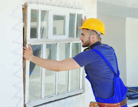 Worker removing old window in flat Stock Photo