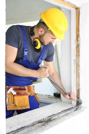 Worker repairing window in flat