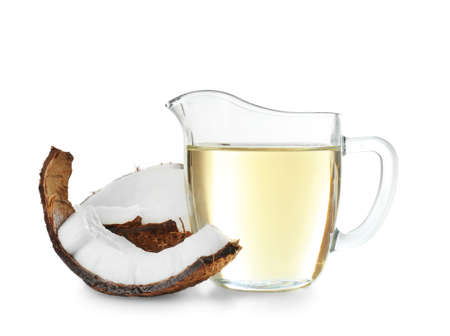 Ripe coconut and pitcher with oil isolated on white Stock Photo