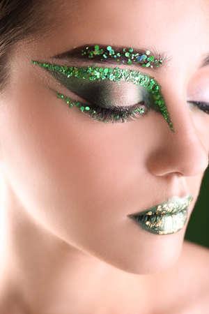 Young woman with creative makeup, close up