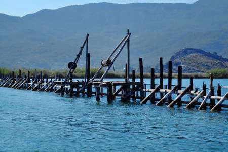 Fencing of fish farm on river