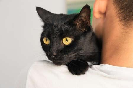 Man holding black cat. Adoption concept Stock Photo