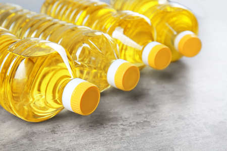 Bottles with cooking oil on table