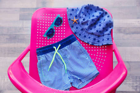 Set of baby beach accessories on chair indoors