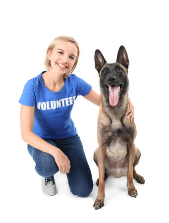 Young female volunteer with dog, isolated on white. Concept of volunteering and animal shelters