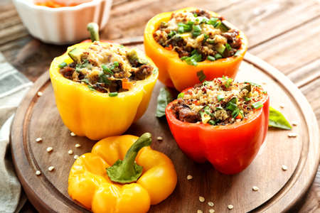 Quinoa stuffed peppers on wooden board
