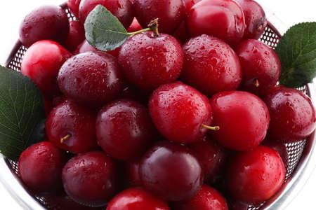 Closeup of ripe fresh plums in colander