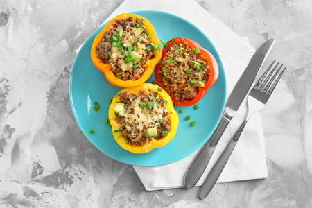 Quinoa stuffed peppers on blue plate