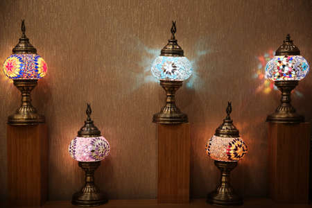 Beautiful Turkish lamps on shelves
