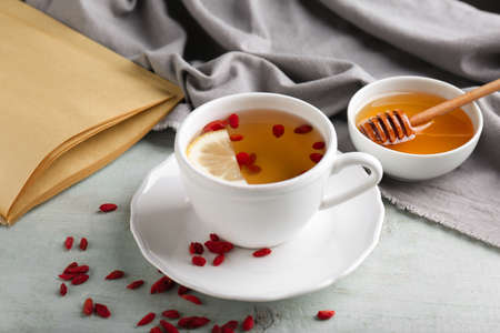 Cup with goji tea on table Stock Photo