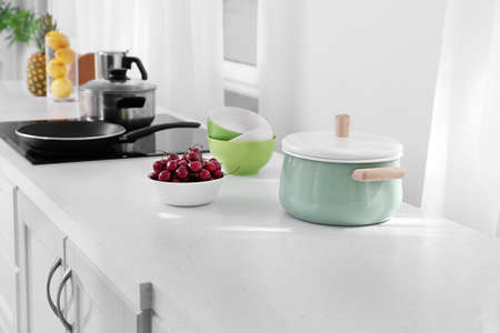 Cookware on table in modern kitchen