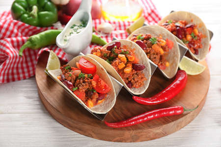 Chili con carne with tortillas on kitchen table Stock Photo