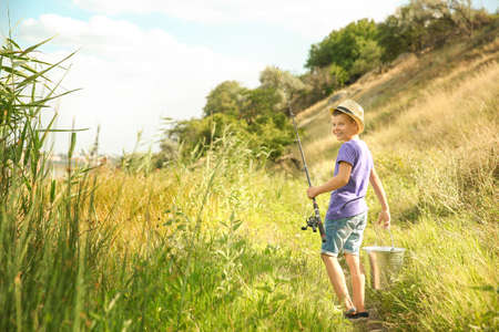 Cute boy going fishing on summer day 免版税图像 - 101881518