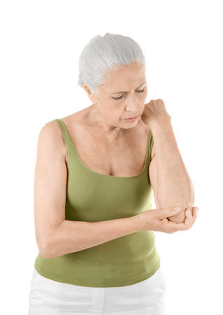 Elderly woman suffering from pain in elbow on white background