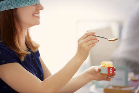 Woman Taking Part In Game At Baby Shower Party Stock Photo Picture