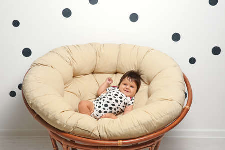 Cute baby lying on lounge at home Stok Fotoğraf