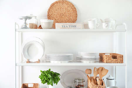 Storage stand with kitchenware, indoors Stockfoto